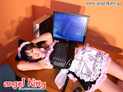 Model wearing the Keyboard Bra laying on the table